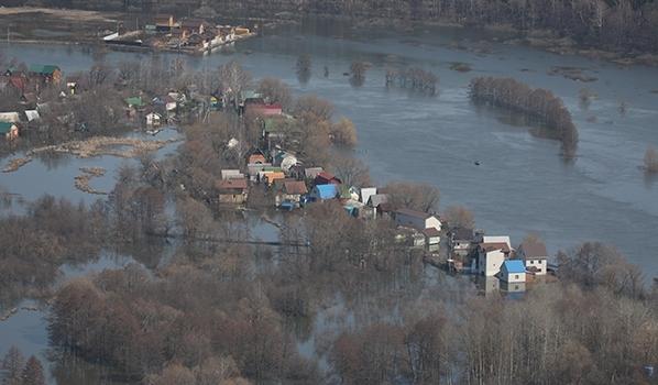 Пострадавшие от паводка уже начали получать компенсации.