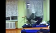 Один кадет избивает другого ногами и руками.
