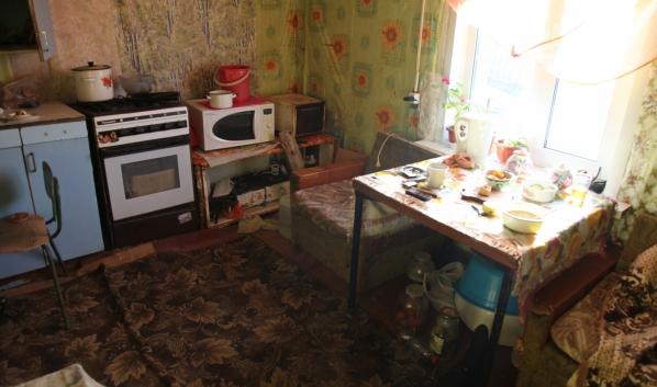 Убийство произошло на этой кухне.