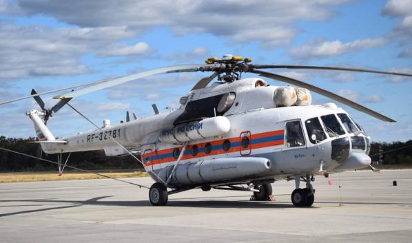 Этот вертолет будет тушить пожар.